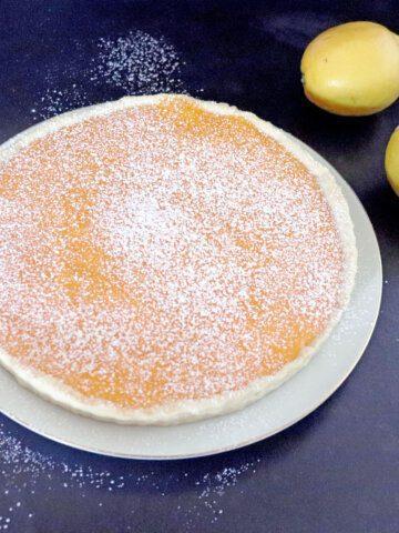 Lemon Curd Tart, entire tart with lemons