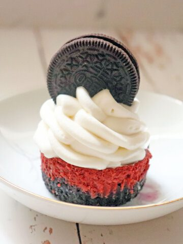 A single Mini Oreo red velvet cheesecake on a plate